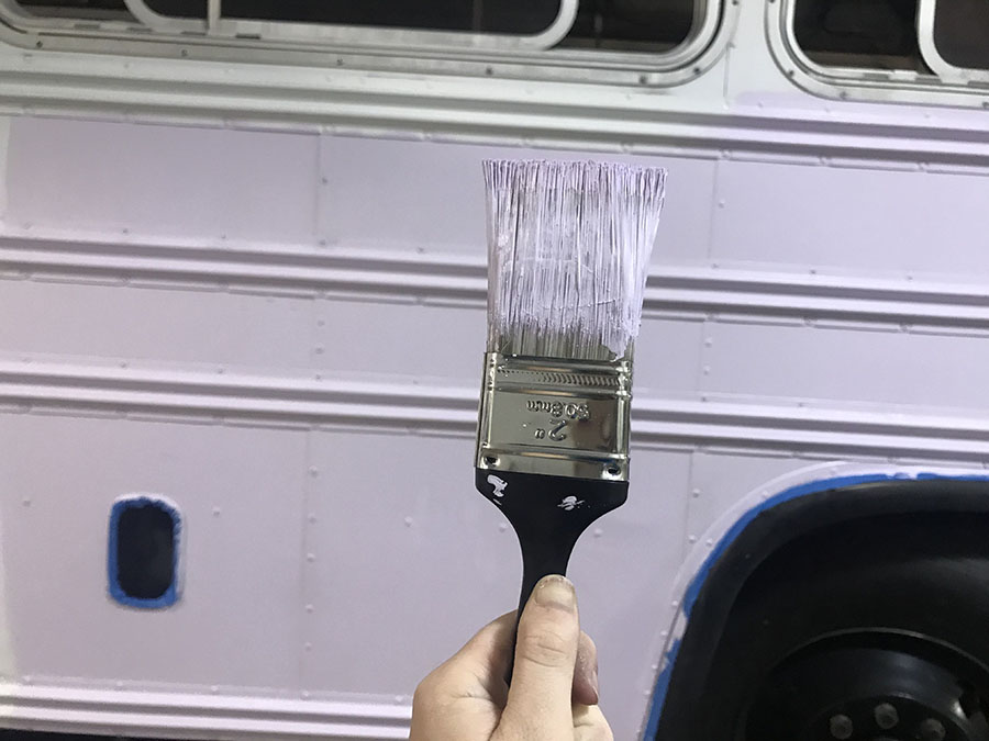 purple paint brush exterior skoolie